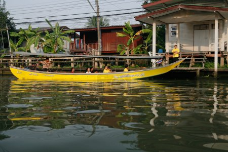 Locals traverse the canals of Bangkok.