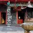 The front of a Buddhist Taoist temple showing carv...
