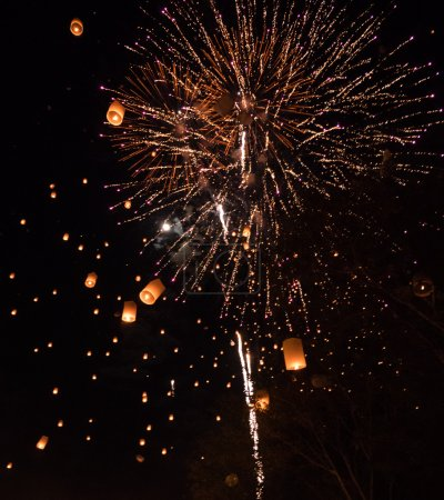 Lanterns and fireworks in sky