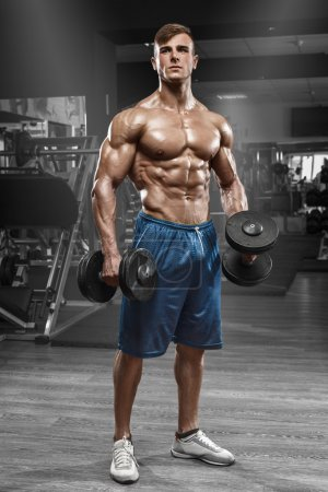 Photo for Muscular man working out in gym doing exercises with barbell, strong male naked torso abs - Royalty Free Image