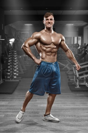 Photo for Sexy muscular man posing in gym, shaped abdominal. Strong male naked torso abs, working out - Royalty Free Image