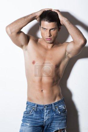 Shirtless muscular man in jeans