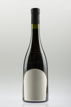 Wine bottle with sloping sides and wide bottom, empty label
