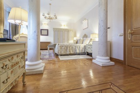 Interior of a classic style luxury bedroom with marble pillars