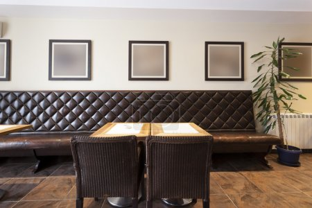 Cafe interior with empty picture frames