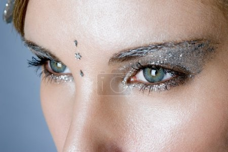 Silver glittery eye make-up