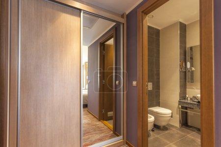 Hotel room interior - bathroom and cupboard