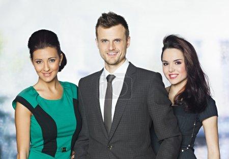 Confident business team of three