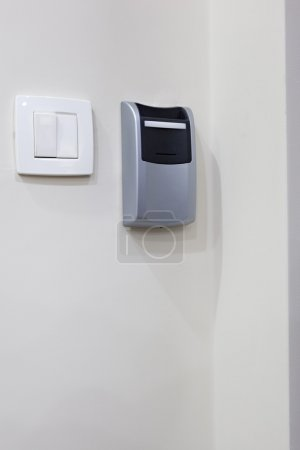 Card key slot and light switch in hotel room