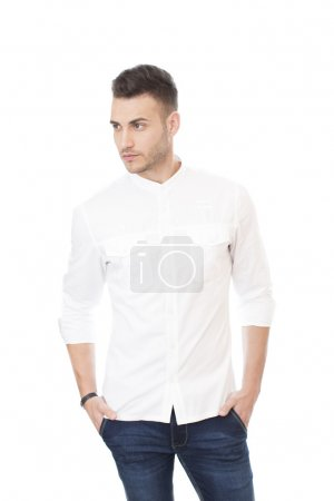 Portrait of a handsome young man in white shirt and jeans