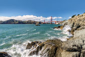 Sea, rocks and bridge Golden Gate