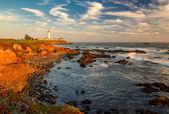 Lighthouse at sunset, Pigeon Point, California coast.