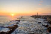 Seascape at sunset. Point Arena Lighthouse on the coast.