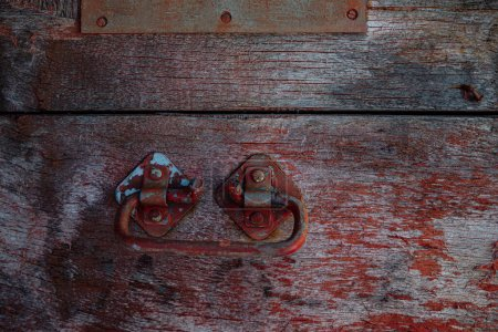 Wooden surface of the box, rusty metal parts, pain...