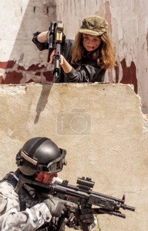 Female with gun to point at soldier