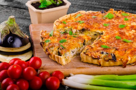 Photo for French Quiche with eggplant, leeks and spring onions, bathed in a delicious cream and baked until crisp - Royalty Free Image