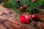 Christmas candle with pine needles