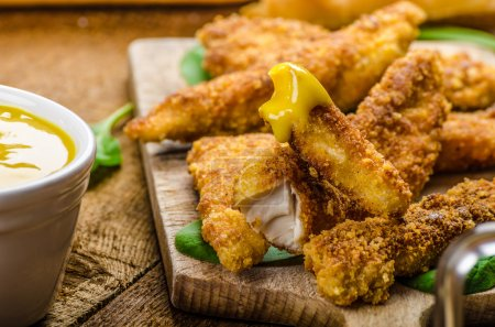 Corn crusted Chicken Tenders with spinach and toas...