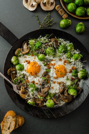 Photo for Vegetable omelet with bulls eye fried egg, mushrooms and Brussels sprouts - Royalty Free Image