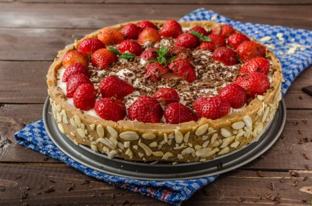 Summer strawberry cheesecake stuffed by nuts and a...