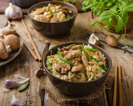 Photo for Chinese noodles with brown mushrooms, simple and delicious fast food. - Royalty Free Image