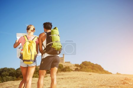 Two young wanderers are taking break between walking in mountains during summer vacation