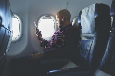 Man listening audio training in headphones