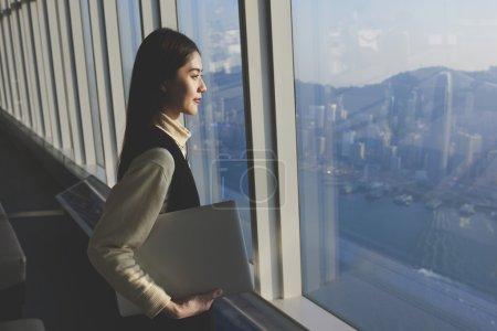 Female successful entrepreneur with laptop computer