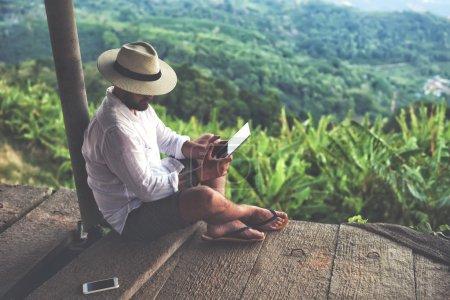 Man traveler using digital tablet