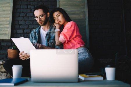 Diverse male and female freelancers analyzing proj...