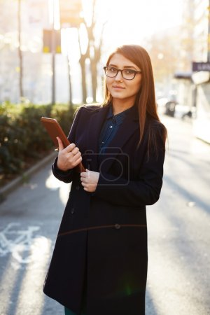 Young businesswoman sitting outdoors