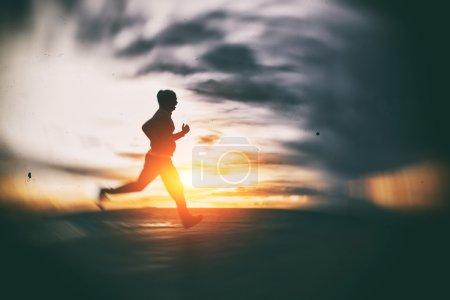 Athlete running at seaside