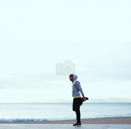 Young  man exercising on beach
