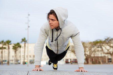 Handsome man doing push ups