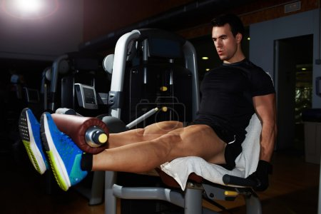 Man doing workout legs exercise