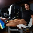 Постер, плакат: Man doing workout legs exercise