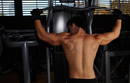 Muscular build athlete exercising