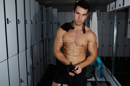 Athlete removing weight lifting gloves