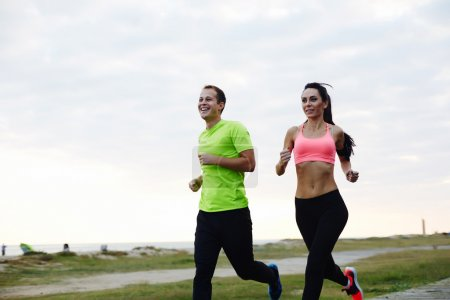 young smiling couple running