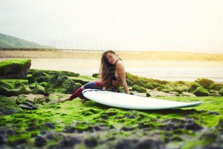Girl resting after surf session