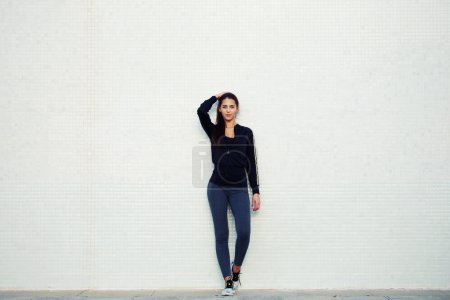 Attractive and sporty young woman standing