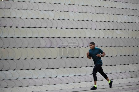 Man running along beautiful grey wall