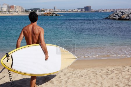 Man with sexy body going to the sea