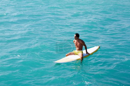 Man enjoying a surf in clear blue water