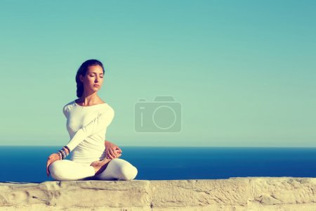 Woman practicing yoga on a sunny day