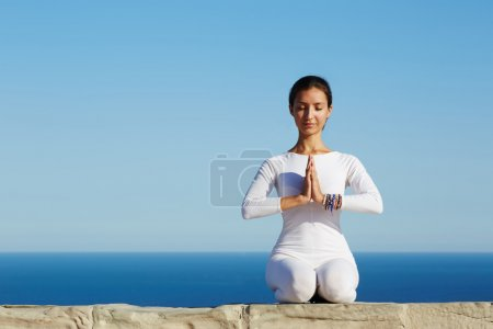 Gorgeous young woman practicing yoga