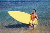 Man holding big surfing board