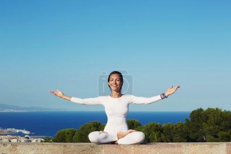 Smiling woman practicing yoga