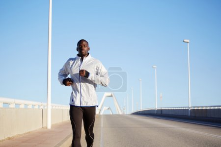 Black sportive man running