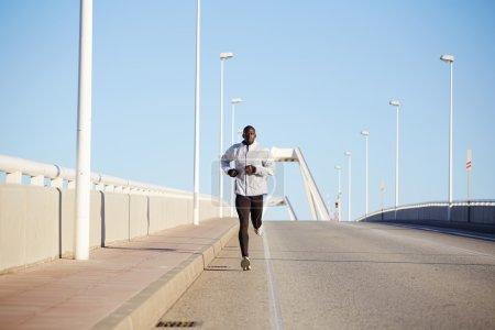 Sportive dark skinned runner training